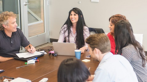 A stock image of a group of people in a meeting