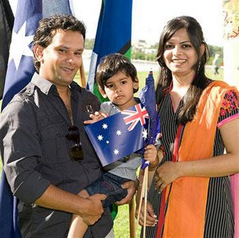 A couple and thir child at a citizenship ceremony